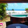 Ste-Anne, vue mer, jardin, jacuzzi, beau et calme T3 standing